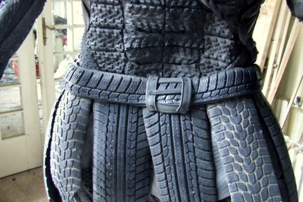 """Barath Gabor's Recycled Tire Art Gladiator Sculptures. I thought that I break with the limitation of shape and I won't use the rounded shape, but I use the markings of the tread. In my opinion tyre is suitable to the dynamically and exciting visualization of animals. """"MUSCULATURE, POWER, DINAMICS"""" – may are the most suitable phrase to describe my creation."""